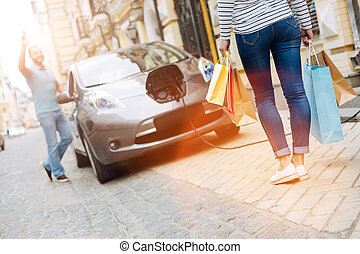 Young woman coming back from shopping - Shopping lover....