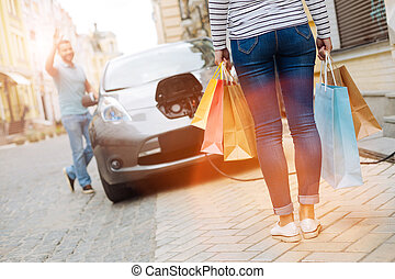 Loving man greeting his wife on her return from shopping -...