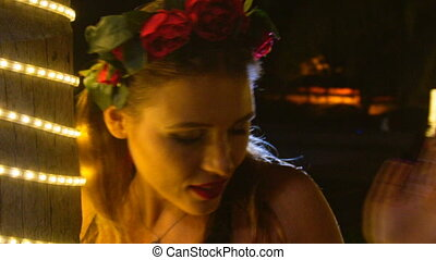 Blond Girl in Red Flower Garland Poses by Tree at Night -...