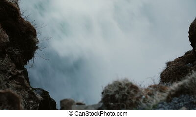 Close-up view of water with splashes and foam, ground....
