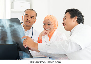 Medical doctors discussing on x-ray scan - Happy medical...