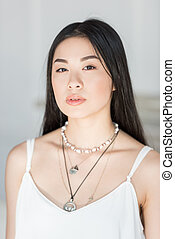 close up portrait of beautiful asian woman in white dress