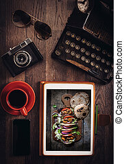Food blog concept with mini tortilla sandwiches on tablet pc...