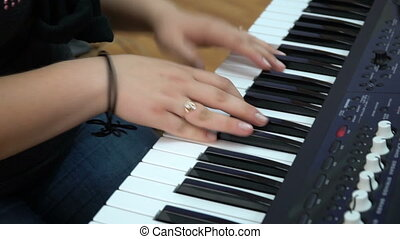 Young woman playing the piano.