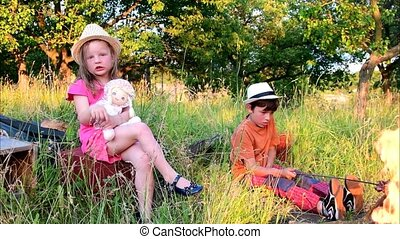 The little children spend the summer time in the garden. Children spend their summer holiday vacation in the garden