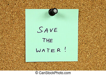 Water conservation - Green sticky note pinned to an office...