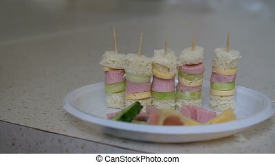 Canape on skewers in a plate.