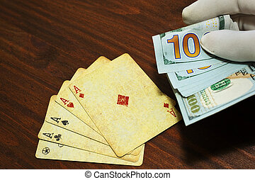 Poker bet in cash holded in a man hand - Poker bet or gain...