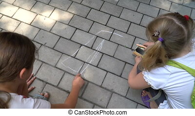 Children paint chalk on the asphalt.