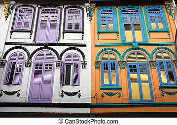 Singapore - Closed colorful window shutters in Chinatown...