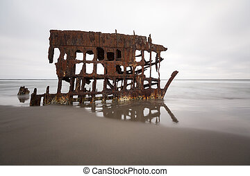 Rusty wrecked ship frame at the beach