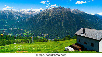 Amazing landscape with a house on the mountains and villages.