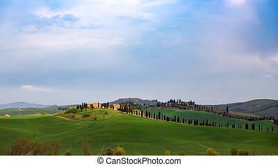 Typical Tuscan landscape - view of a villa on a hill and...