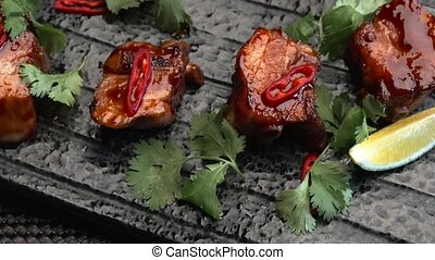 fried meat with red pepper and grass - fried pieces of meat...