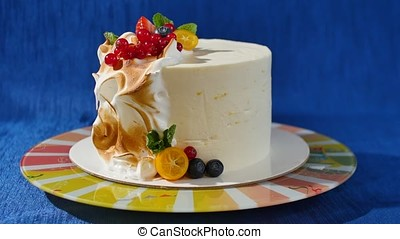 Traditional Christmas fruit cake with white frosting and sugared fruits. Cream cake with kumquat, cranberries, strawberries