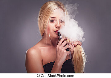 Young sexy blonde is vaping. Studio shooting,