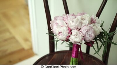 Wedding bouquet on chair indoors