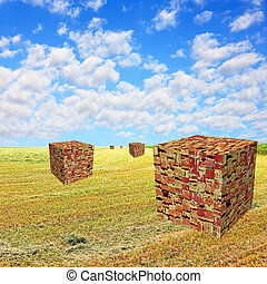 Cube shape brick stacks on yellow field against blue cloudy...