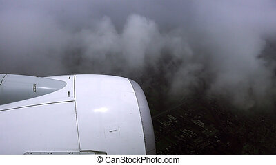 Airliner is flying in a bad weather conditions. Non-flying...