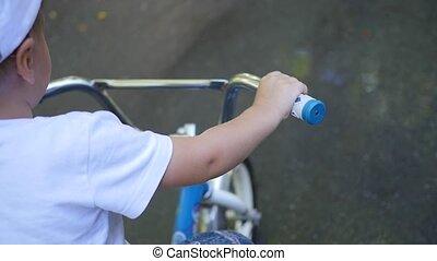 A child riding a children's bike closeup
