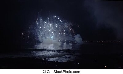 Fireworks in night sky - Fireworks blowing in night sky and...