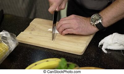Cook cutting marmalade with knife