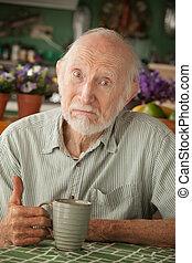 Senior man with mug