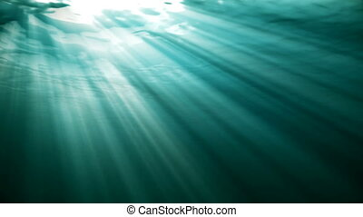 High quality Looping animation of ocean waves from realistic underwater. Light rays shining through