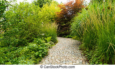 A narrow path in the park. - A narrow path in the park