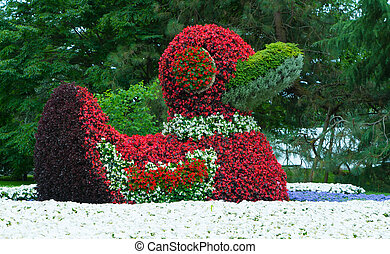 Close-up of a figure of ducks made from flowers. - Close-up...