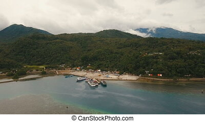 Sea passenger ferry port aerial view .Camiguin island,...