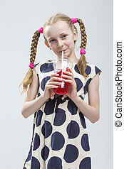 Portrait of Funny and Curious Smiling Caucasian Girl With...