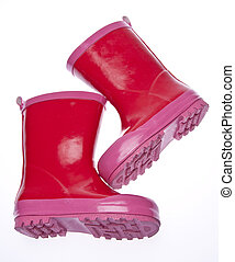 Pink Galoshes - Pink rain boots isolated on white with a...