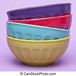 Stack of Vibrant Bowls - Stack of vibrant colored bowls on a...