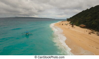 Aerial view beautiful beach on tropical island in stormy...