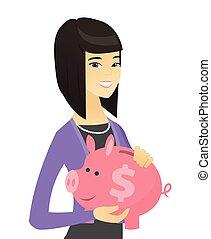Asian business woman holding a piggy bank.