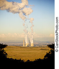 Smoke Stacks - Four massive smoke stacks from a coal fired...