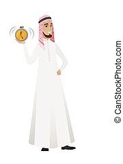 Muslim businessman holding alarm clock.