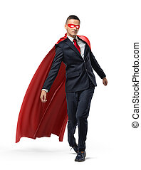 A businessman with glowing eyes wearing superman red cape...