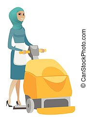Muslim worker cleaning store floor with machine. Young...