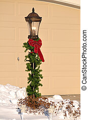 Lamppost Decorated for Christmas with Red Bow and Garland
