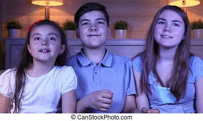 Children watching music programs on TV - Children are...