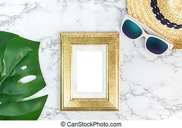 Blank Vintage golden color picture frame on green monstera...