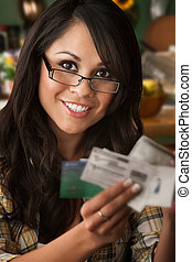 Beautiful Latina Woman with Coupons - Beautiful Latina Woman...