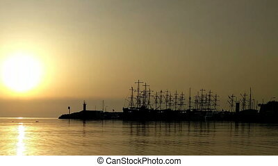 Sailing ships and sun - Sailing ships against the backdrop...