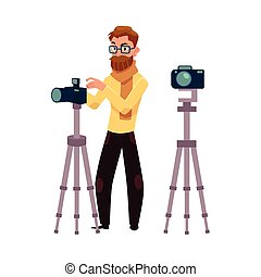 Photographer taking pictures, shooting in studio, digital camera and tripod
