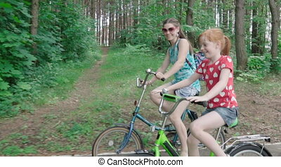 Mother and daughter riding a bicycle