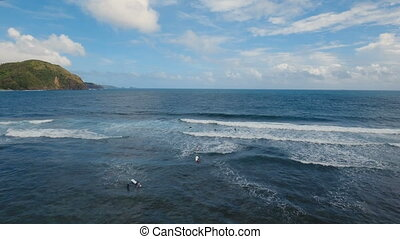 Aerial view surfers on the waves.Catanduanes, Philippines. -...