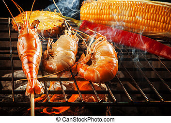prawn ,shrimp grilled on barbe-que fire stove with pineapple...
