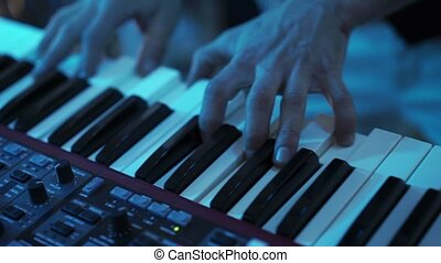 Man playing piano keyboard closeup